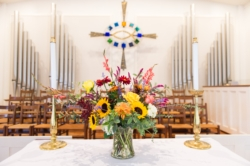 An altar table set with flowers in the Rock Spring Church sanctuary