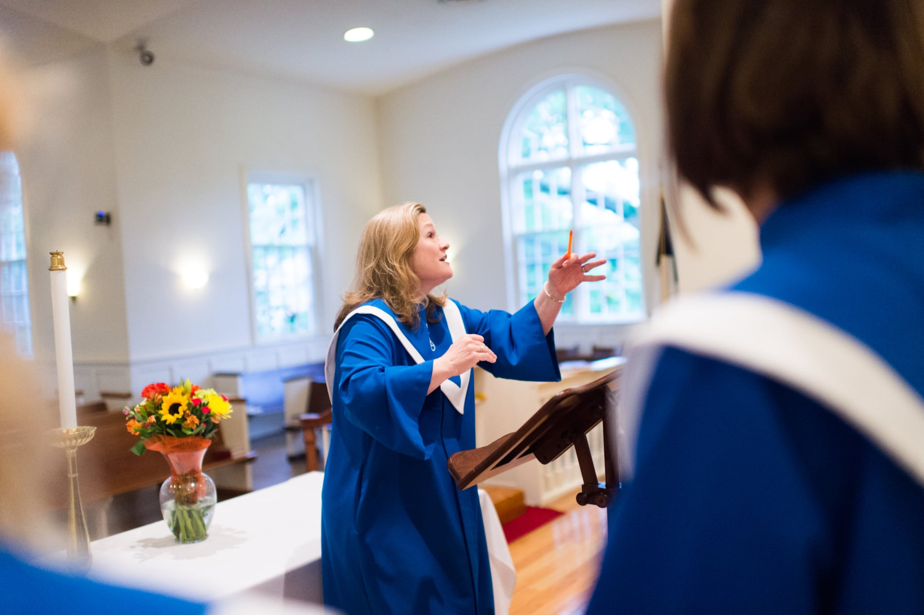 The director of music conducts the church choir