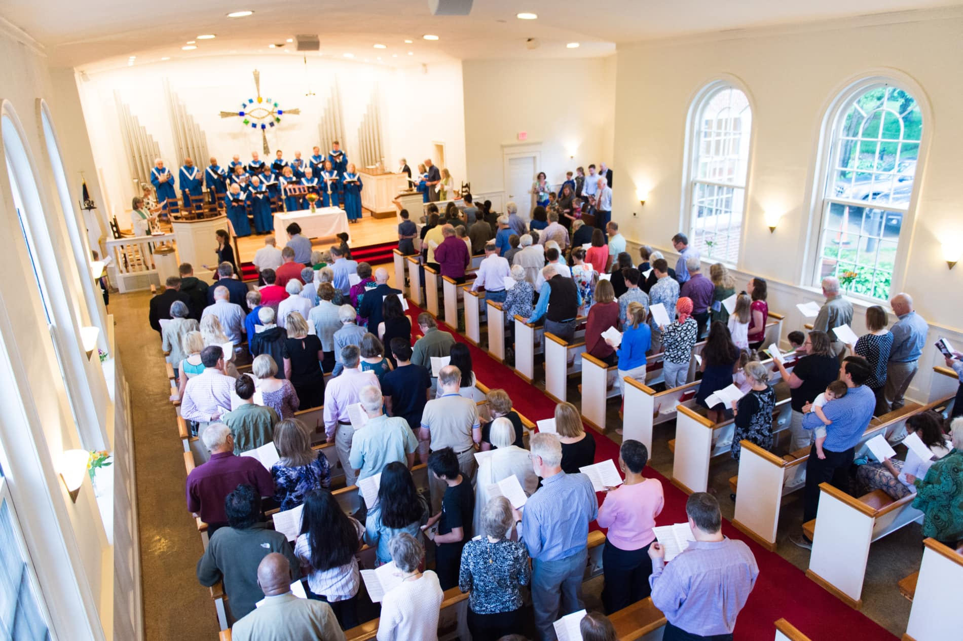 A wide angle view of the Rock Spring sanctuary full of people in worship