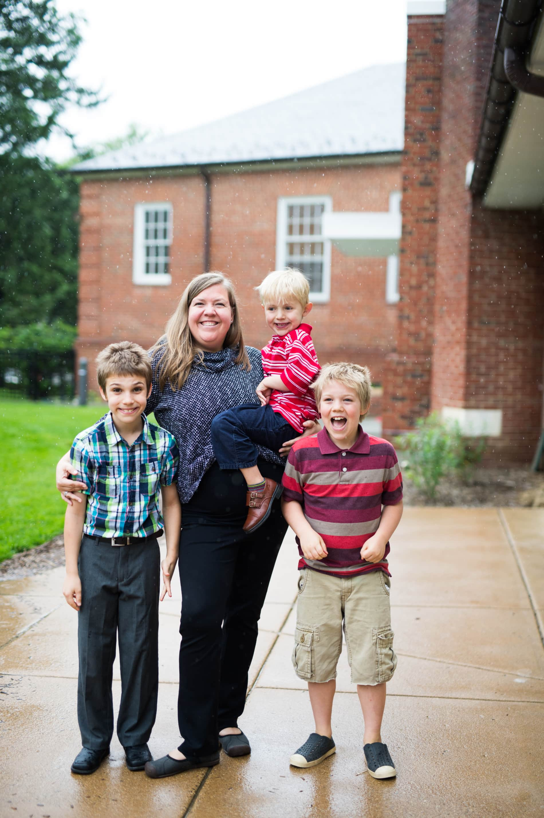 A mother and her three sons stand outside of church