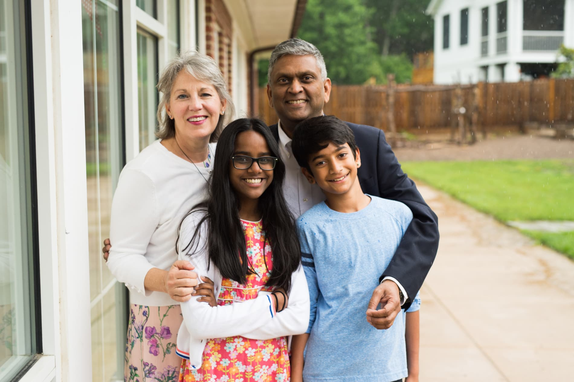 An interracial family of a mother, father, daughter and son