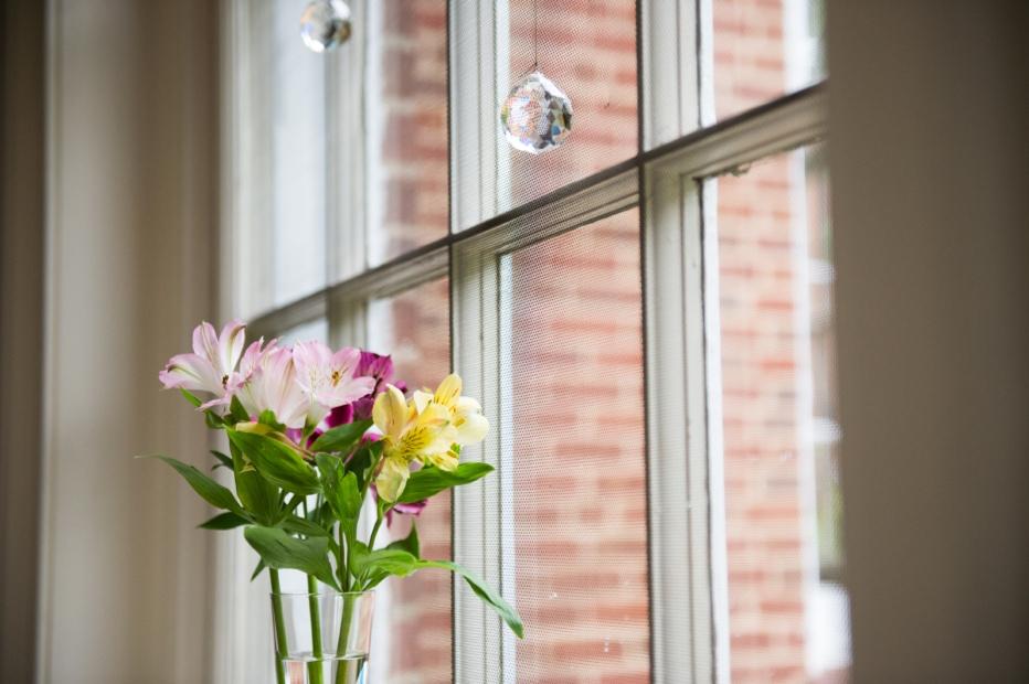A vase of flowers in a window