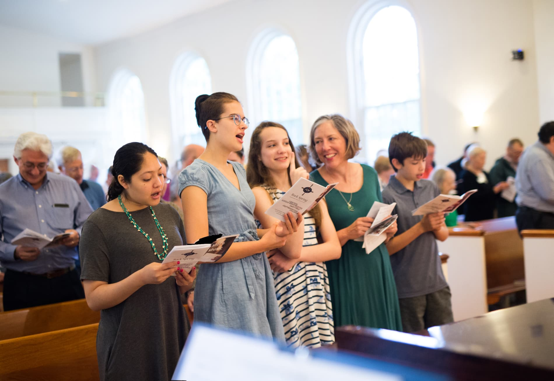 A group of people singing in church