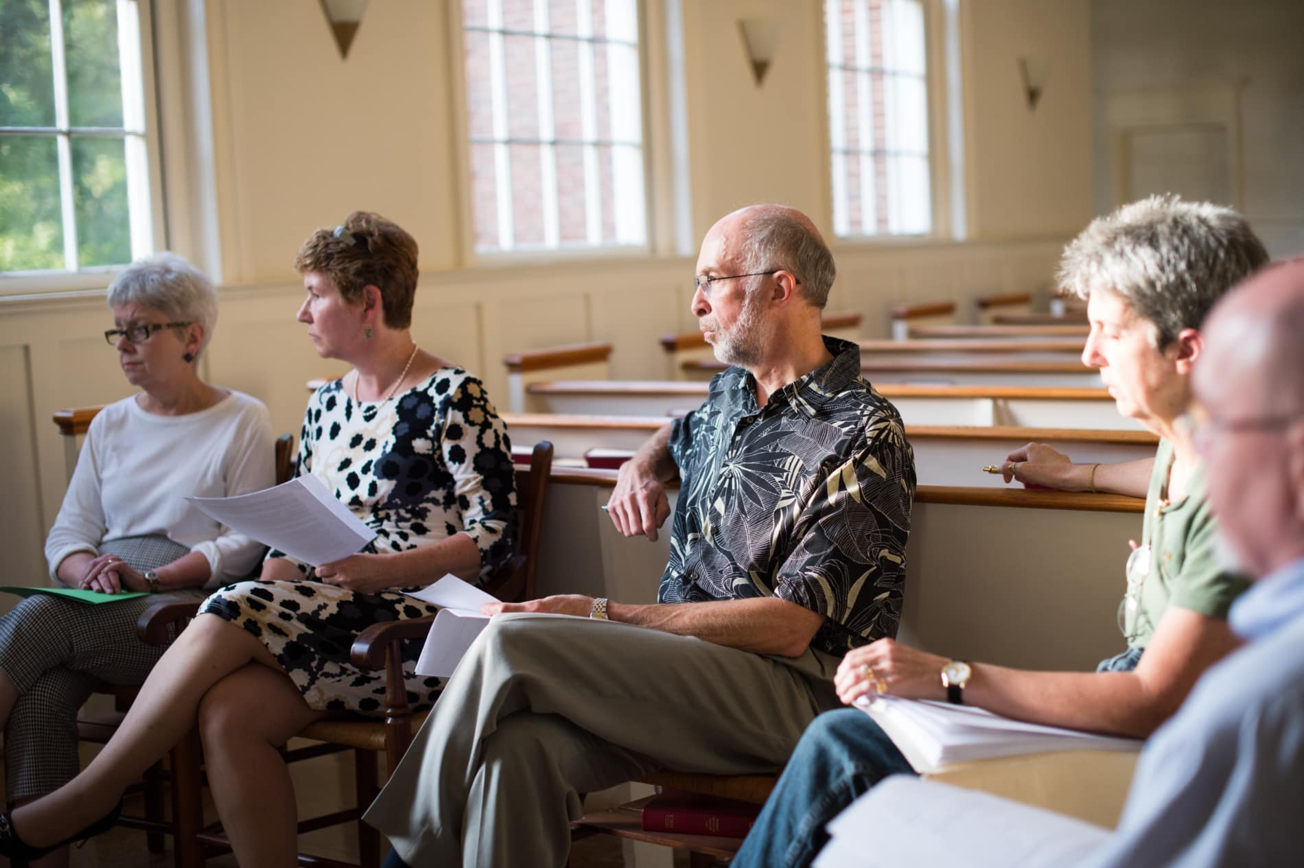 A group of adults engaged in conversation about Christianity
