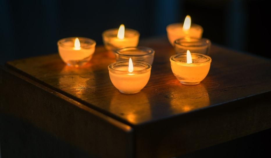 Five lit candles